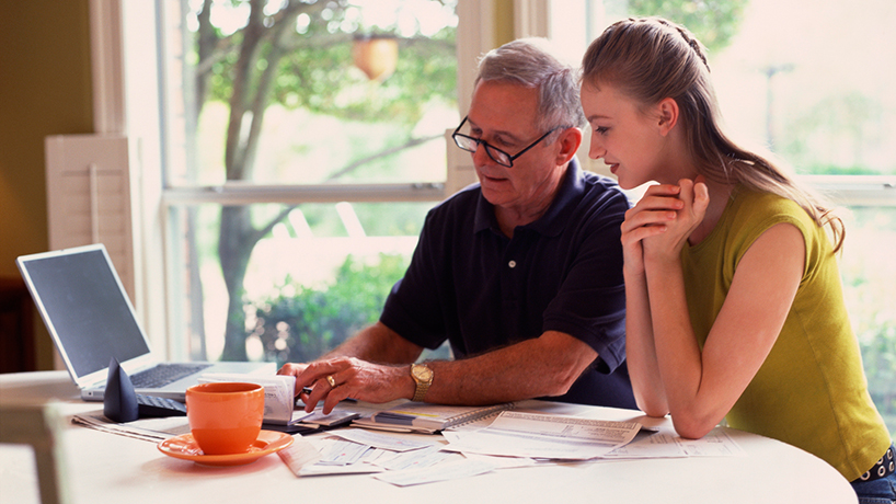 Father going over finances with his daughter