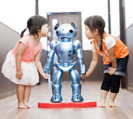 IMAGE OF TWO GIRLS WITH ROBOT