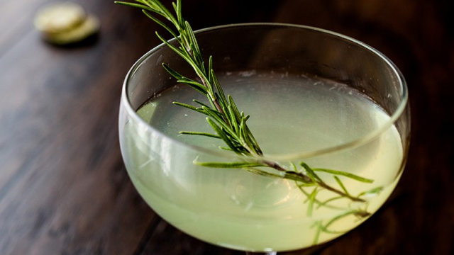 A mojito with rosemary