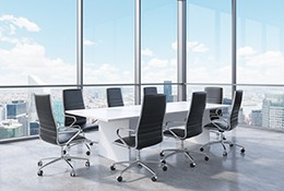 A conference room overlooking a cityscape