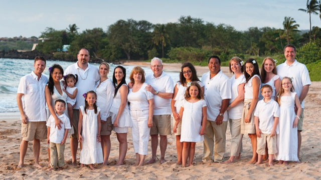 A multi-generational family at the beach