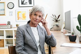 Older woman sitting at a desk