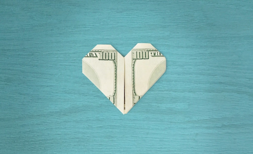 Money folded into the shape of a heart