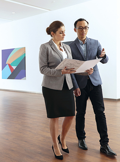 Professionals reviewing documents in an Art museum