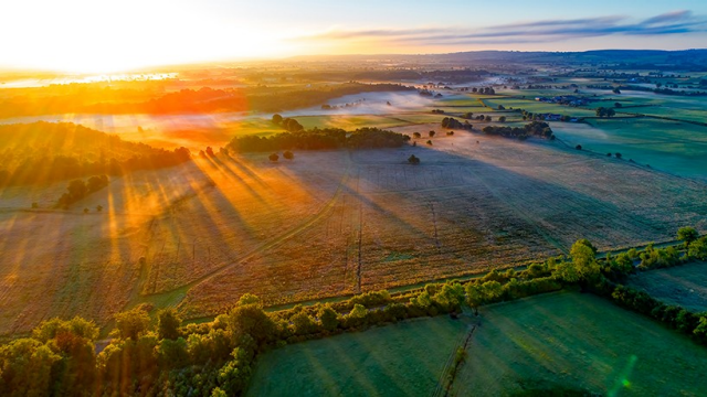 Ariel view of a farm at sunset
