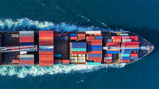 Overhead photo of a cargo ship at sea
