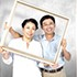 Couple posing with a frame