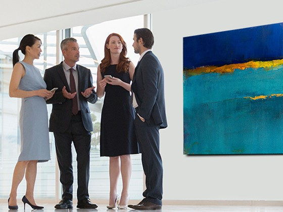 professionals having a conversation in front of a painting