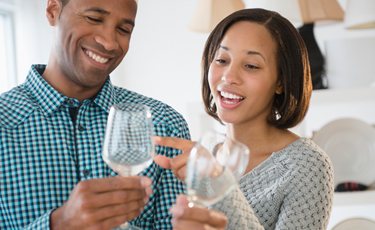 man and woman with wine glasses